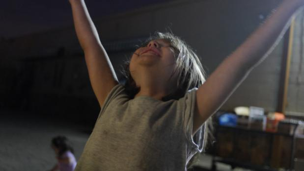 young girl from a TC Drupal party raising her arms in celebration